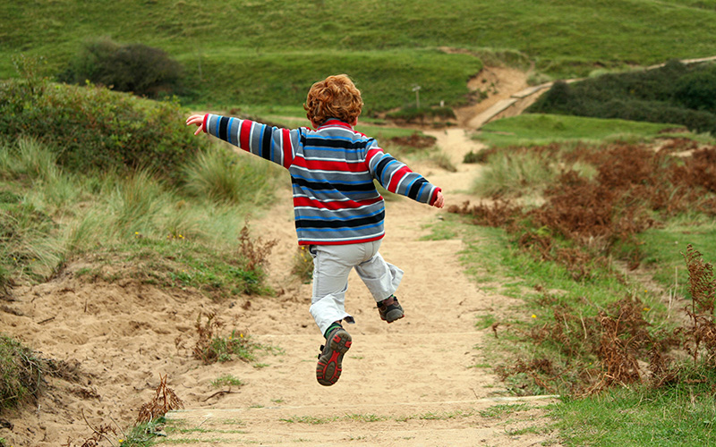 Boy skipping in the countryside